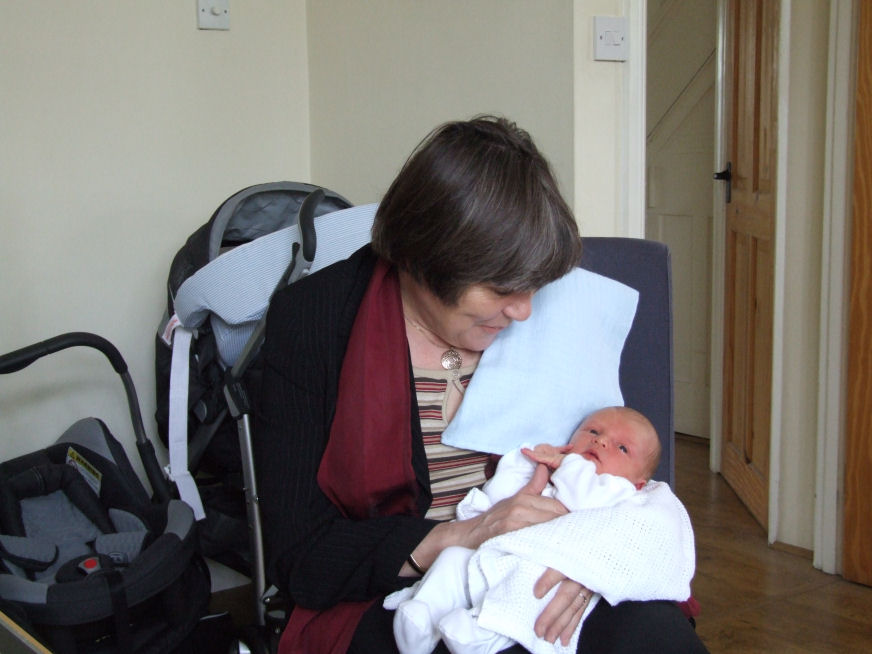 Alexander Frederick (Alex) in the arms of his grandmother, Rhian