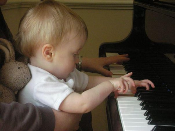 Alex taking piano lessons with his mother